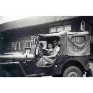 Old photo of a Jeep with Mr Lehmann and his son at the wheel