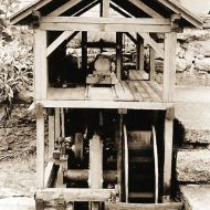 Old photo of a model waterwheel and sawmill