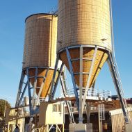 Complete facility in Vienna (Austria) consisting of two round larch-wood silos, with a steel base and operating platform