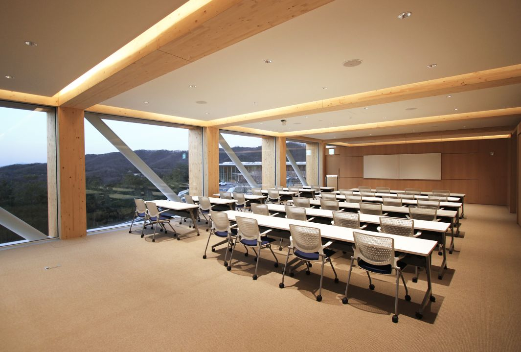 Haesley Nine Bridges Golf Club, interior shot of a classroom in the Learning Centre at dusk, with artificial light
