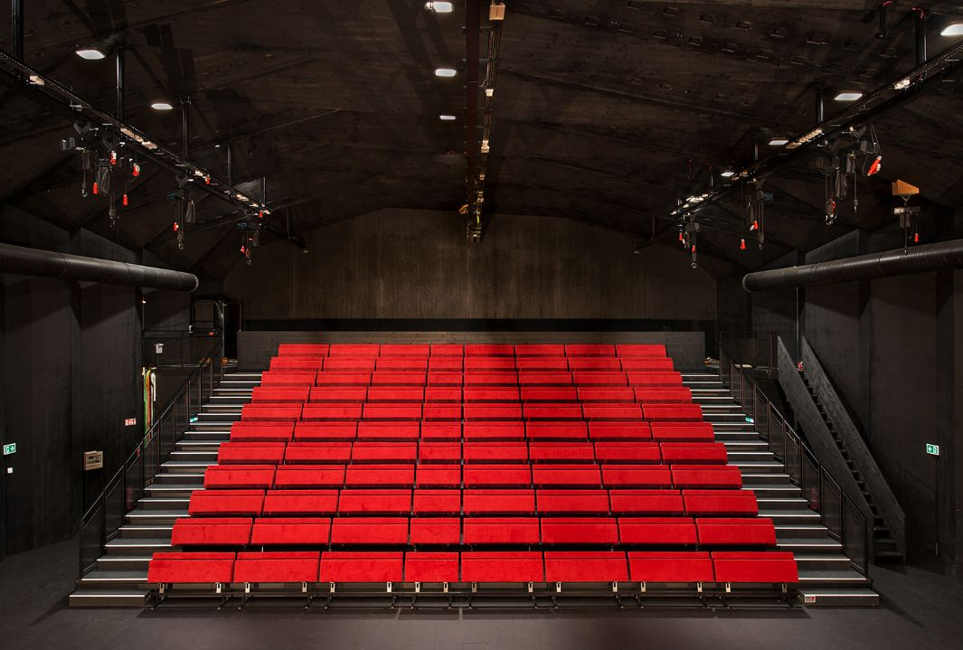View of the red seating in the theatre with black background