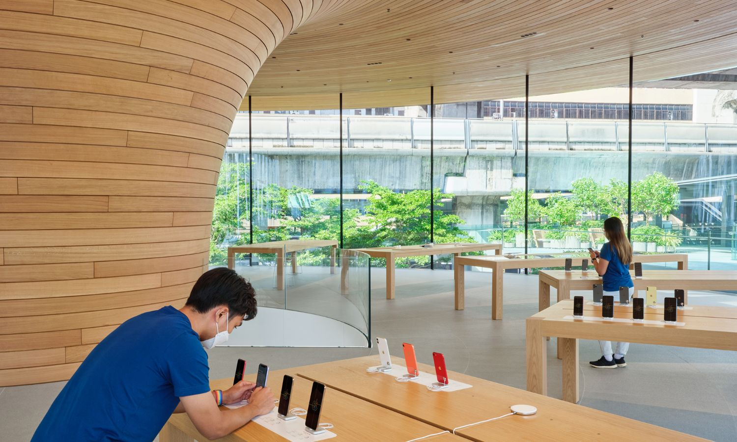 Product presentation in the Apple Store Bangkok under tree canopy