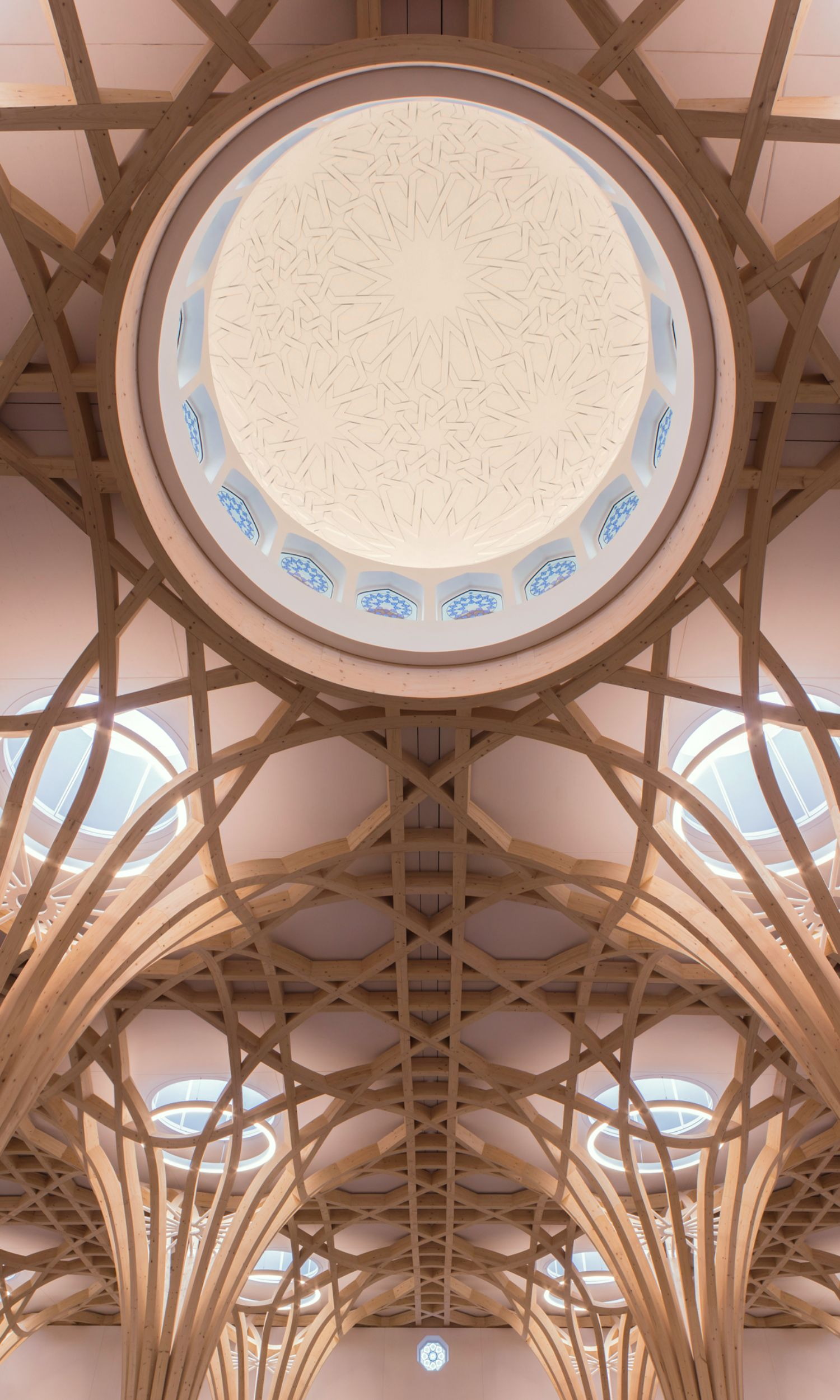 Photograph taken beneath the dome of the Cambridge Mosque from the inside. The tree-like wooden supporting structures can be seen around the dome.