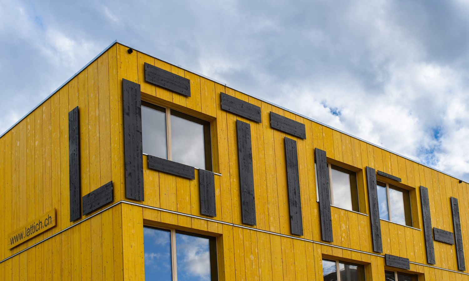The yellow building of the Lattich Areal in St.Gallen with the striking black lettering