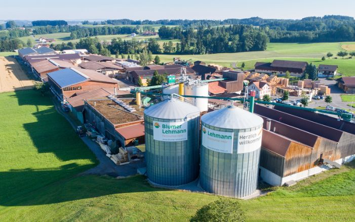 Aerial view of the Lehmann Group premises, showing two large pellet silos, in summer.