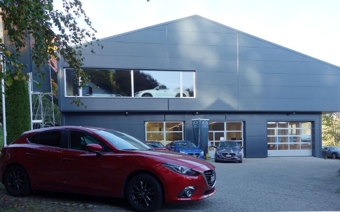 Overall view of the Mazda garage with car parked in front
